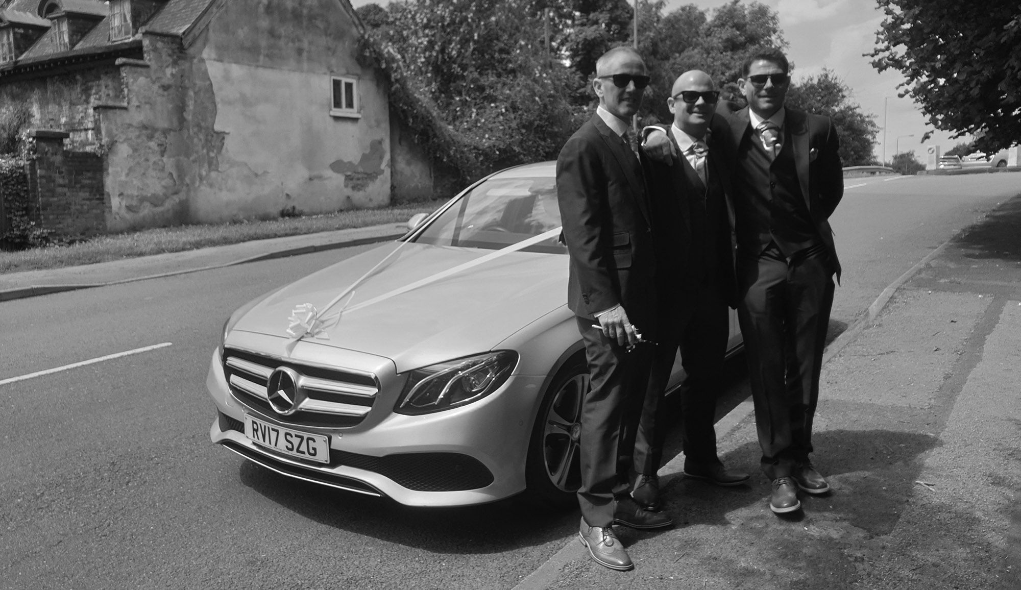 wedding entourage with their wedding car